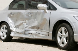 silver car with side damage